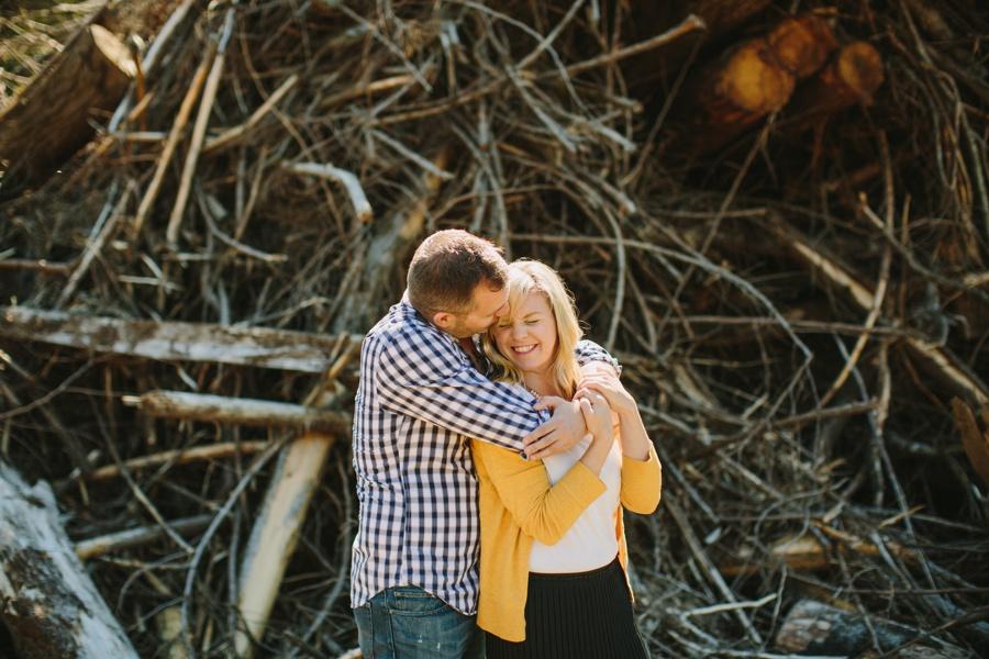 Hugging next to logs