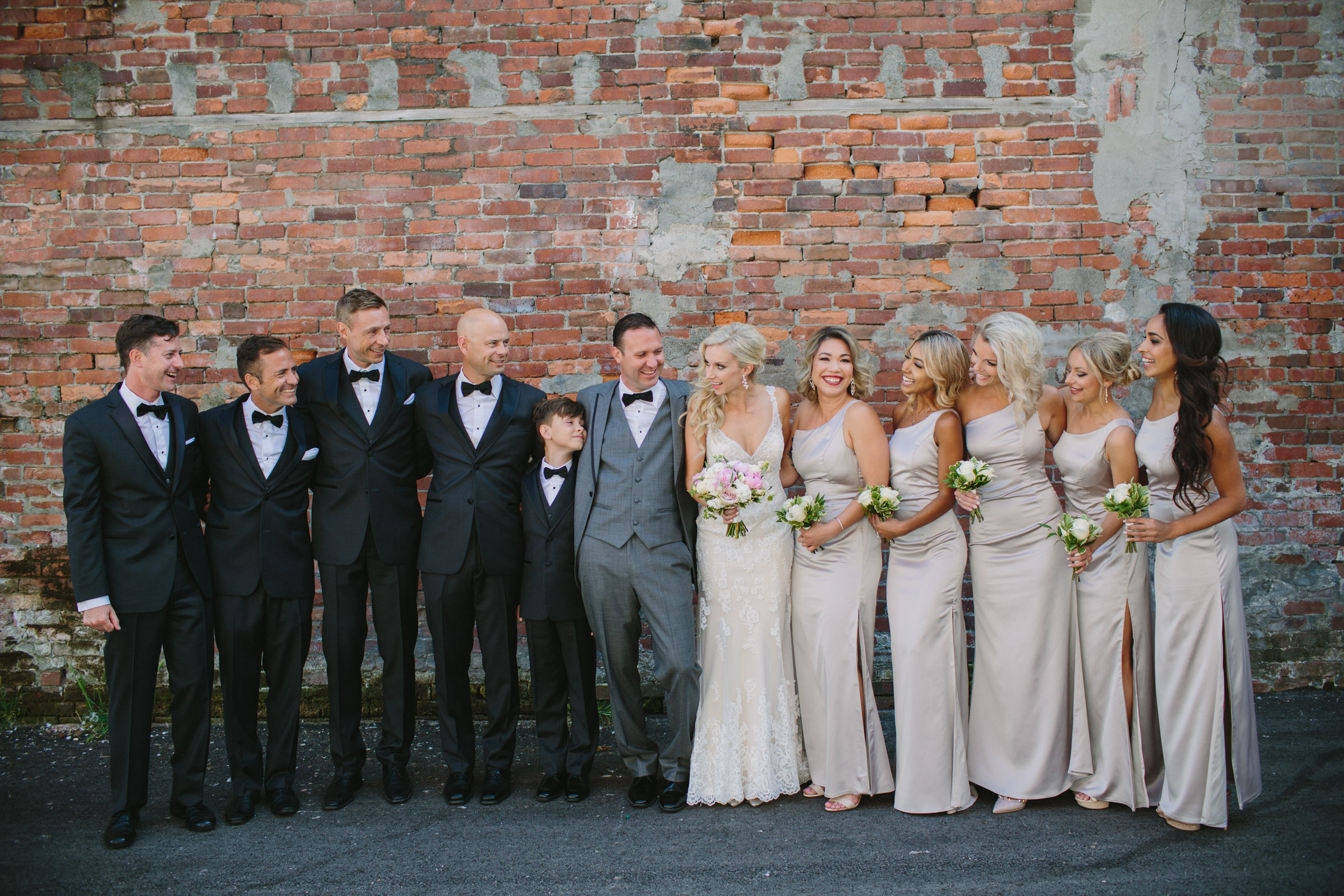 Vancouver Wedding Party in front of brick wall