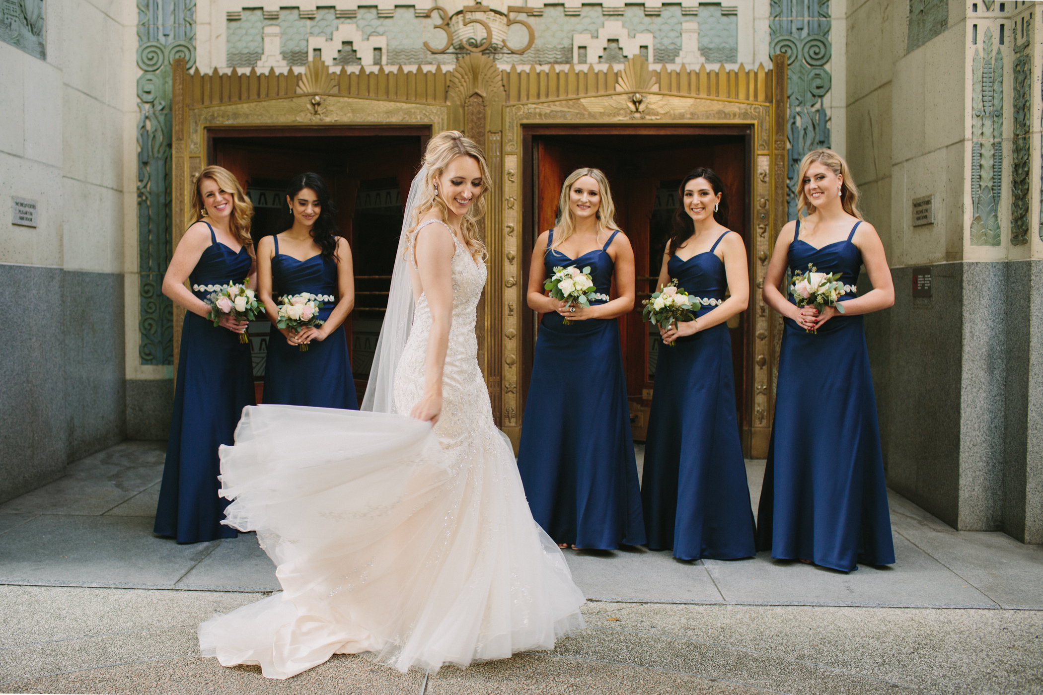 Bridesmaids in front of the Marine Building