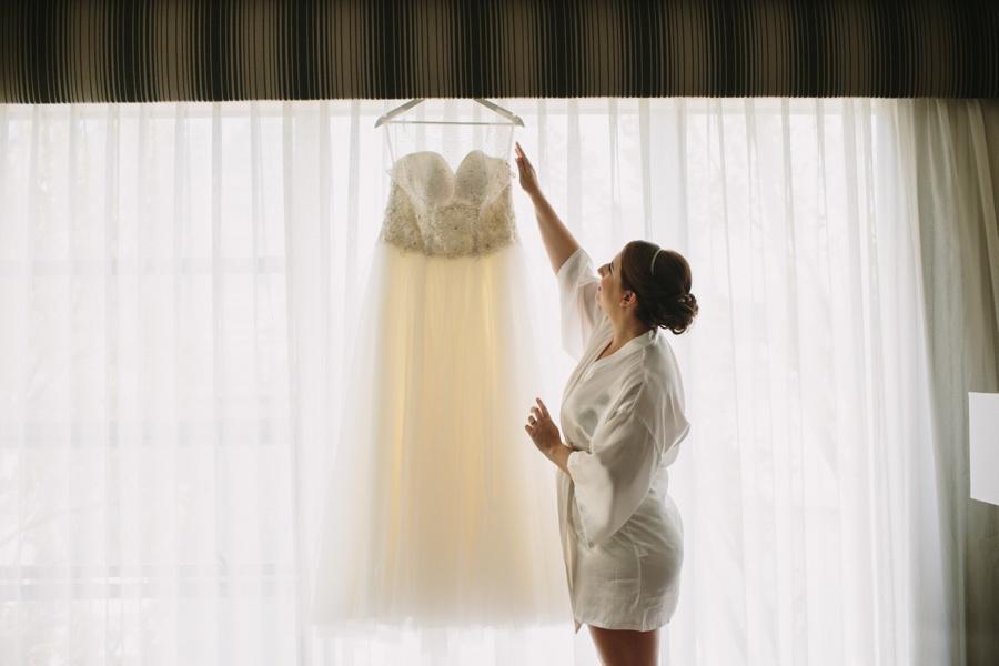 Science World Wedding Bride Putting on Dress