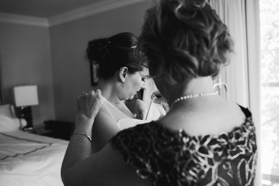 Vancouver Bride Putting on Wedding Dress