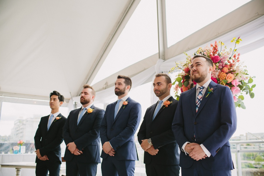 Groomsmen during ceremony at Science World in Vancouver