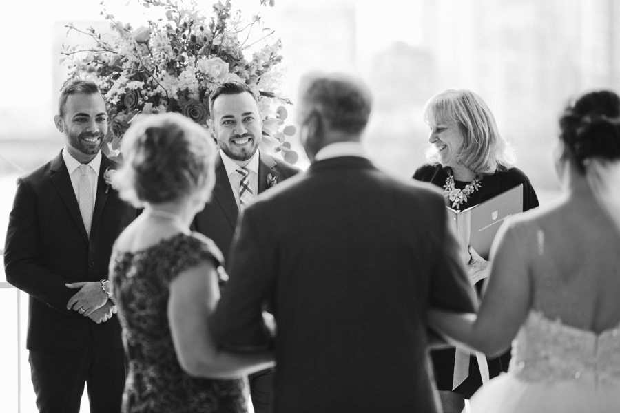 Groom's reaction to bride at Science World Wedding Ceremony
