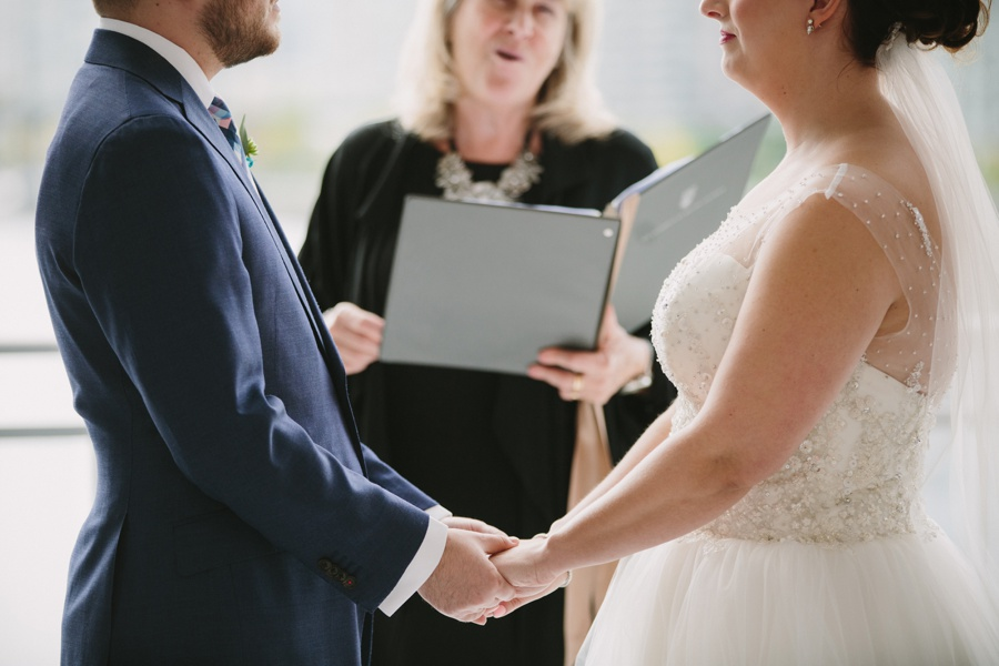 Holding Hands during Science World Wedding Ceremony
