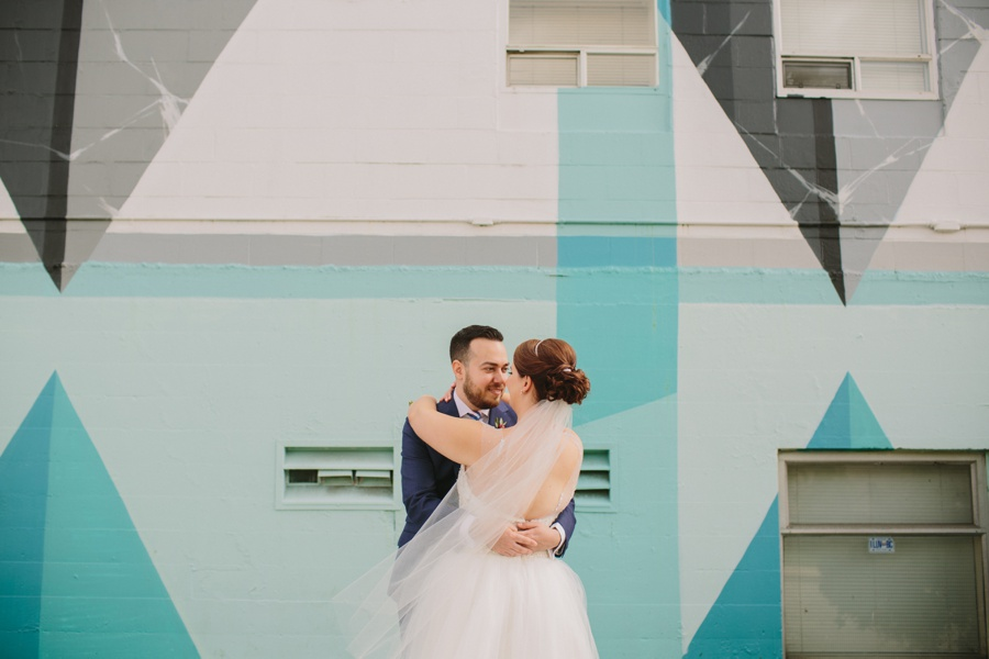 Bride and Groom Photos in front of Vancouver Mural