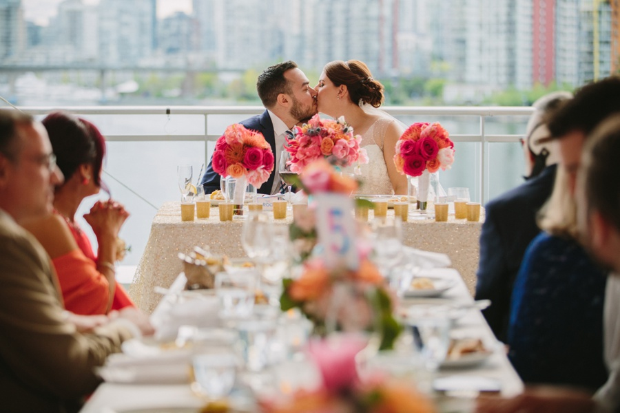 Bride and Groom Kiss During Reception at Science World