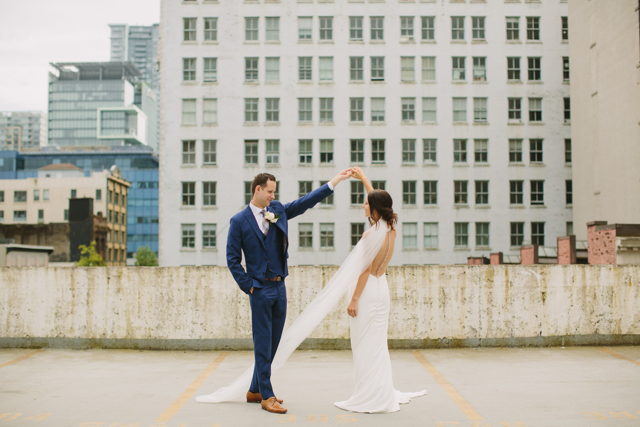 Bride and Groom Dancing with the Seymor Building