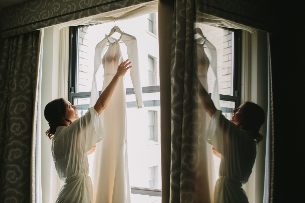 Bride getting into dress at Fairmont Hotel Vancouver