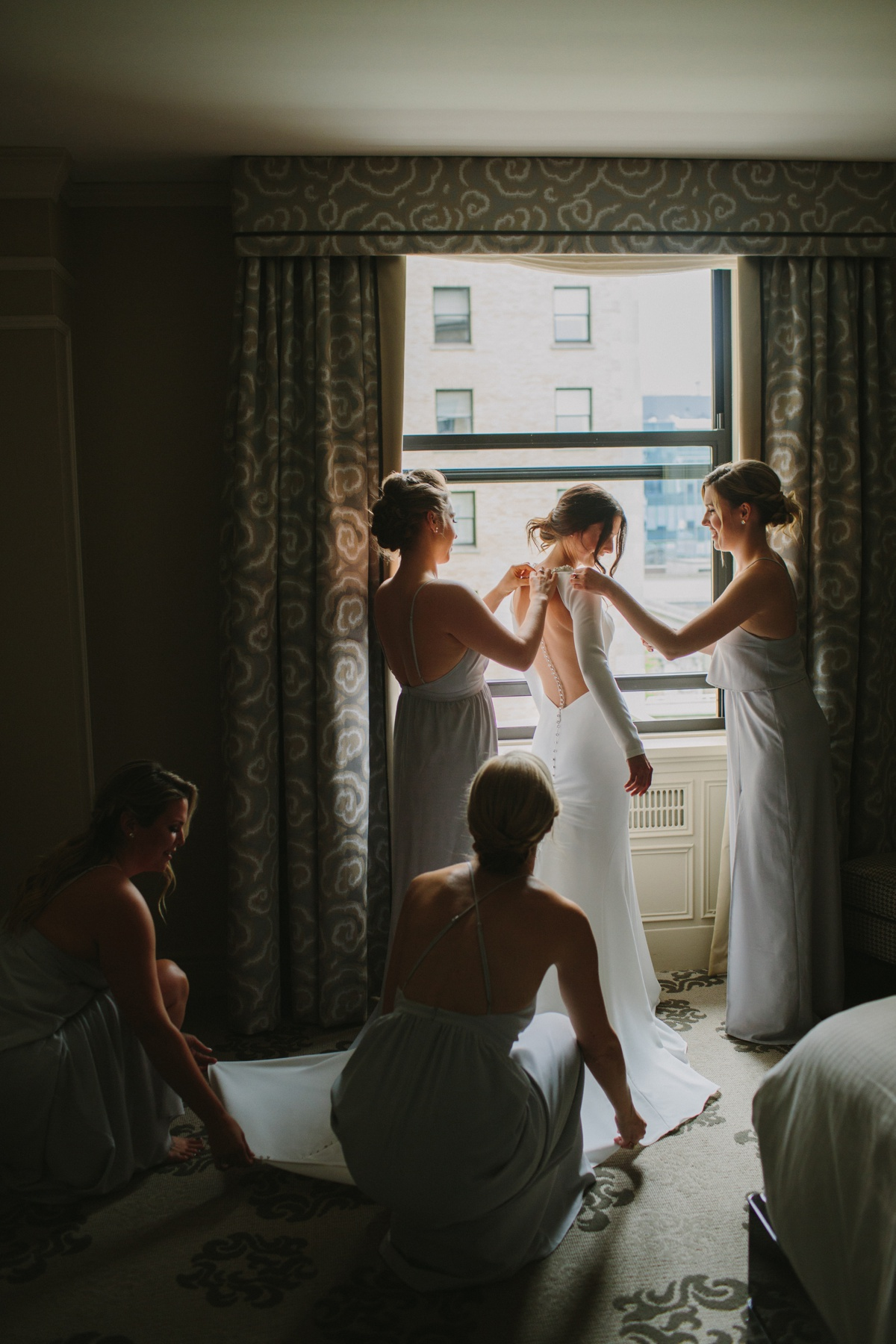 Bride with bridesmaids at Fairmont Hotel Vancouver