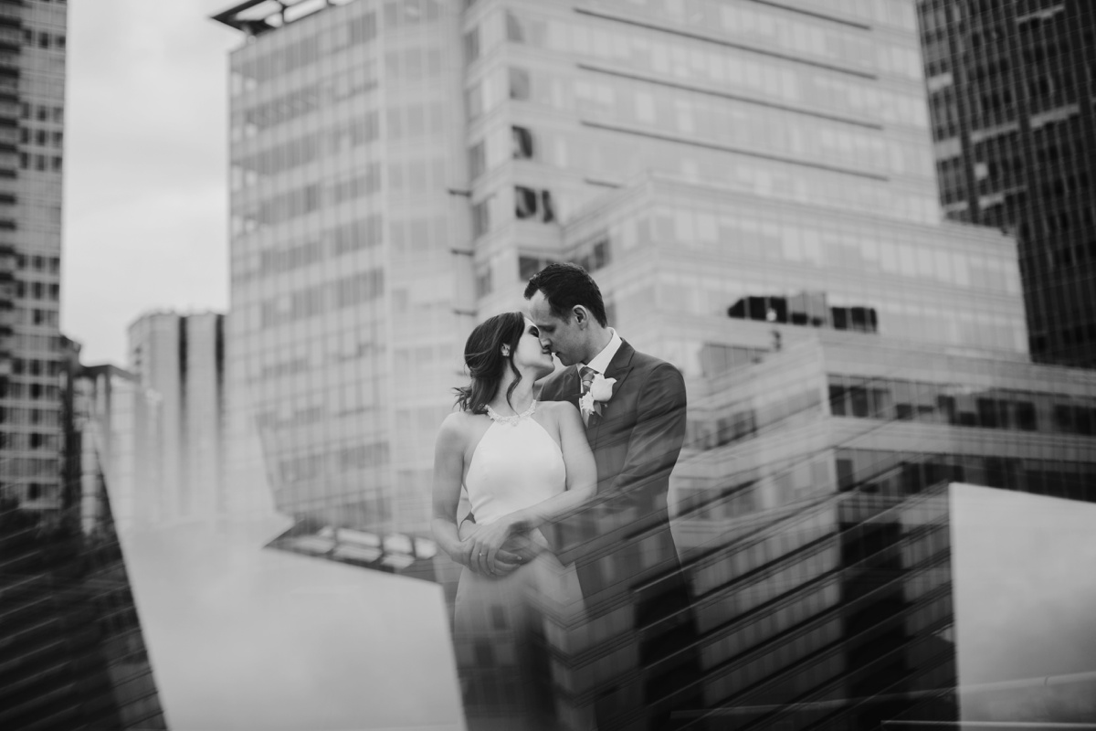 Creative portrait of bride and groom with Vancouver skyline