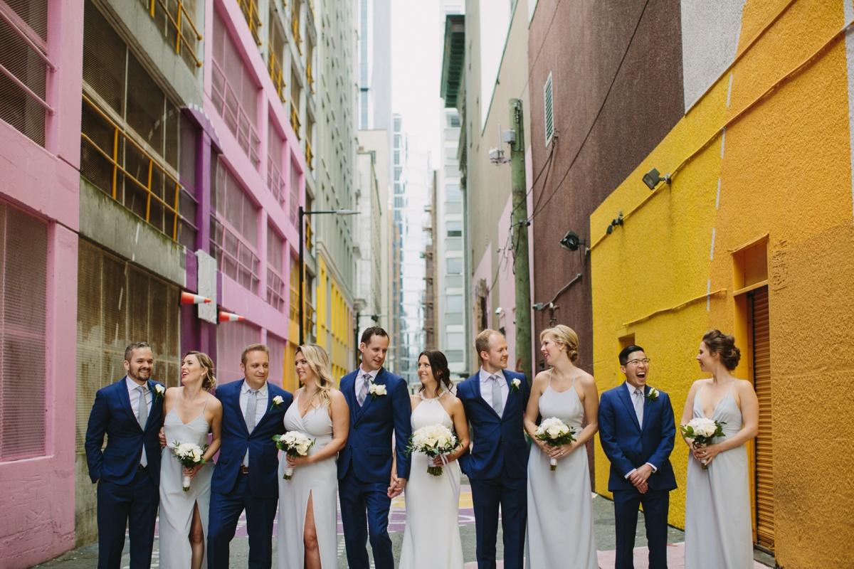 Wedding Party posing in Alley-oop