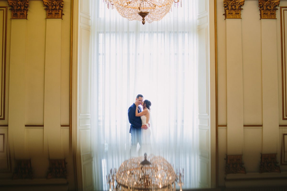Bride and groom with Fairmont Hotel Vancouver grand staircase