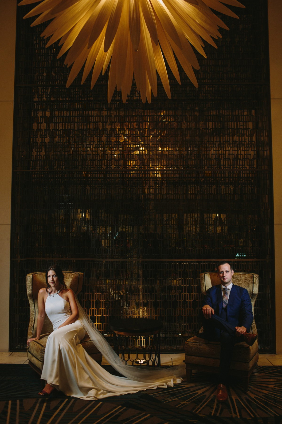 Wedding couple poses in Fairmont Hotel Vancouver