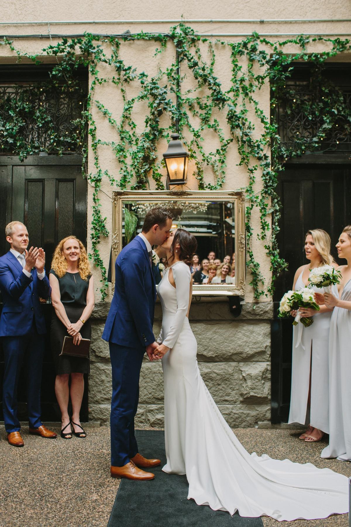 First kiss at Brix & Mortar wedding