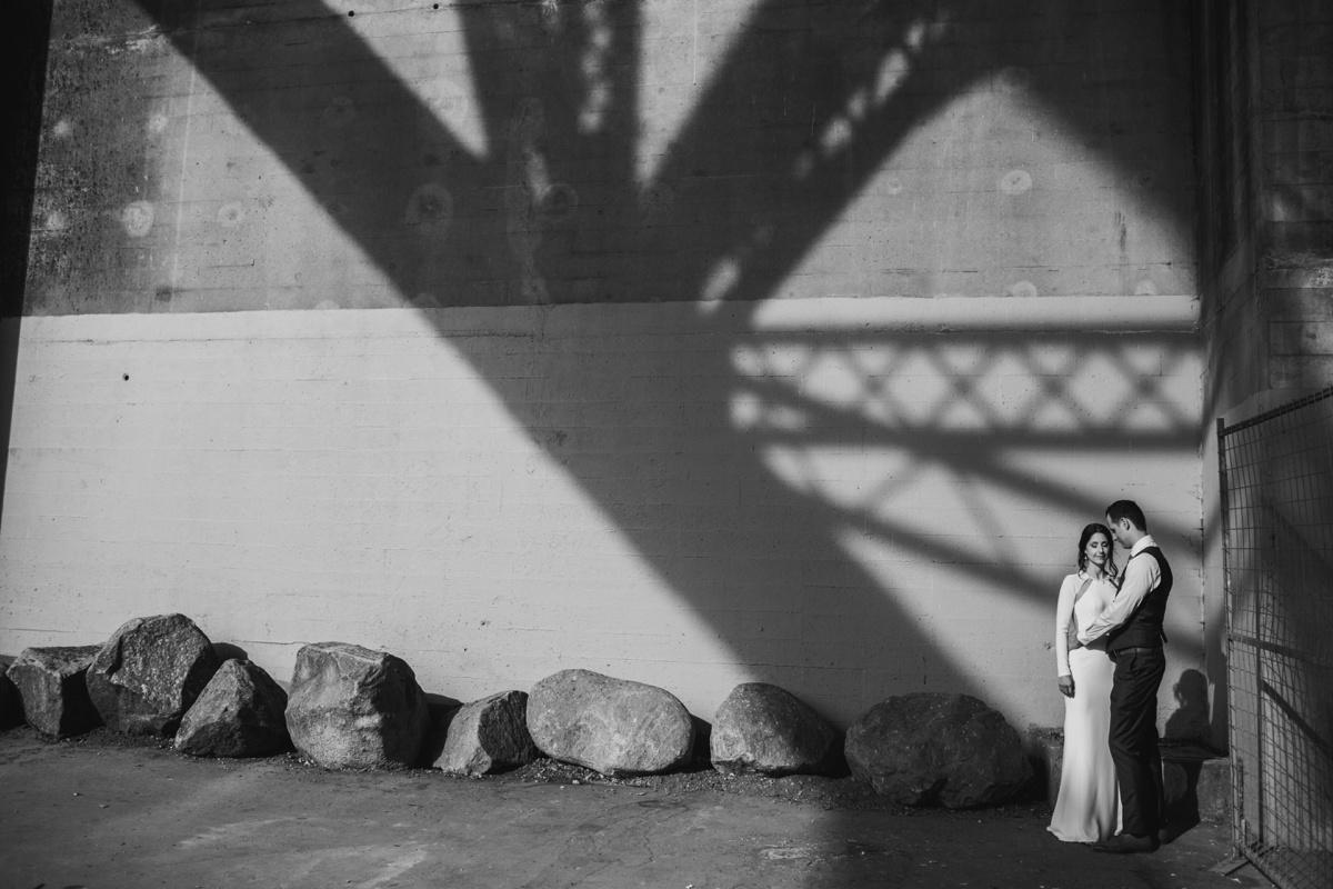 Wedding portrait under Burrard Street Bridge in Vancouver