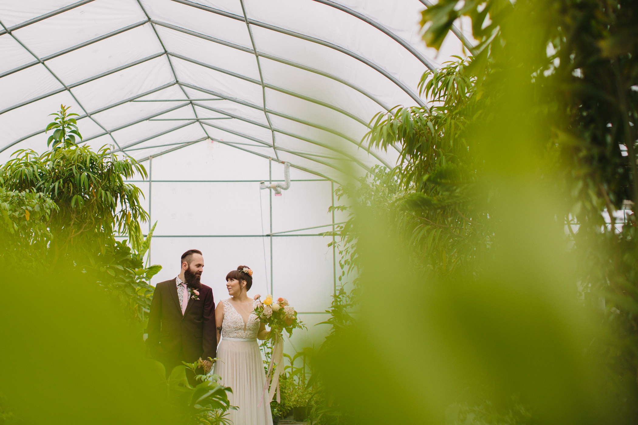 Bride and Groom Portraits in Greenhouse at Secret Gardens